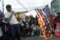 USA flag burning protest in Ecuador