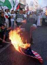 Burning the American flag in Palestinian territory.