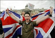 A Londoner celebrates with a Union Jack in Trafalgar Square as the announcement is made that London will host the 2012 Olympic Games. Britain's newspapers hailed London's victory  with full colour front pages of the city's joyous  celebrations(AFP/Paco Serinelli)